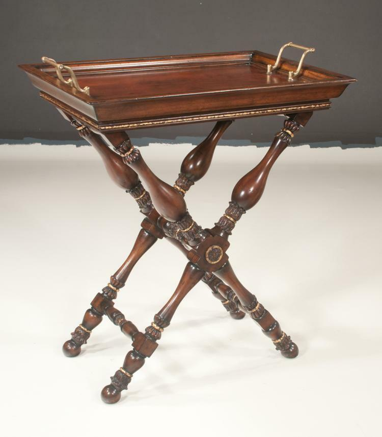 Mahogany butler's tray with moulded top, brass handles and on a turne... Lot 373