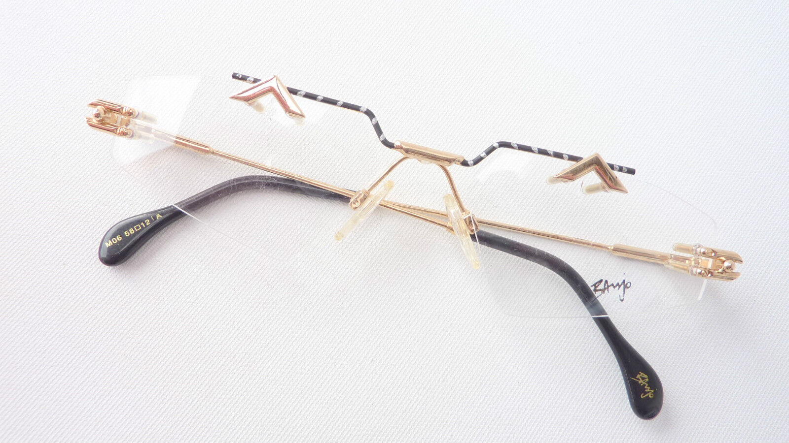Unusual Eyecatcher Banjo Rimless Designer Glasses Black Gold Top Size M