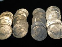 1 ROLL OF BU 1984 D KENNEDY HALF DOLLARS.