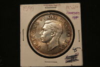 1949 CANADA SILVER DOLLAR HIGH GRADE MS64 UNCIRCULATED. TONED.