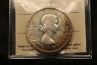 1959 CANADA SILVER DOLLAR. ICCS MS 64 SATINY LUSTRE SOME TONING.
