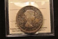 1959 CANADA SILVER DOLLAR MS 64 ICCS. THICK COLORFULLY TONED COIN.
