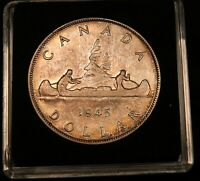 1945 CANADA SILVER DOLLAR.  DATE. NICELY TONED COIN.