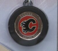 2009 CALGARY FLAMES $1 DOLLAR MINI PUCK AND MINI STICK SET. COLORIZED NHL IN OGP