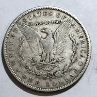 1884 TONED CHOICE AU MORGAN SILVER DOLLAR. LOT2