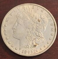 1895 S MORGAN DOLLAR IN ABOUT EXTRA FINE CONDITION M202