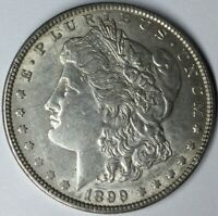 1899 $1 MORGAN SILVER DOLLAR AU UNCERTIFIED