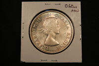 1961 CANADA SILVER DOLLAR. NICELY TONED WITH SATINY LUSTRE. NEAR GEM UNC.