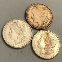 LOT OF 3 CLEANED AU MORGAN SILVER DOLLAR COINS. 1885, 1886 & 1889. Q