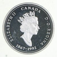 WORLD SILVER COIN   ABOUT QUARTER SIZE   1992 CANADA 25 CENT