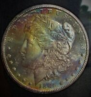 1885-CC RAINBOW TONED MORGAN DOLLAR NGC 65 [STAR] GRADED