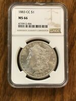 1883 CC MORGAN SILVER DOLLAR, NGC MINT STATE 66, A WHITE AND SHINY BEAUTY