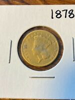 1878 3$ GOLD COIN..MINOR DAMAGE..LOOKS LIKE IT WAS USED AS A