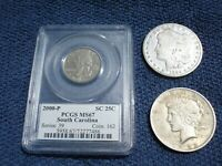 THREE COINS:1884 MORGAN  1922 PEACE SILVER DOLLARS 2000 SOUTH CAROLINA QUARTER