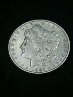 1887 P MORGAN SILVER DOLLAR EXTRA FINE  BRIGHT WITH SOME LUSTER IN SAFLIP R65