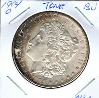 1904-0 MORGAN SILVER DOLLAR GRADES CHOICE BU TONED C3186