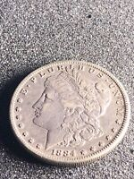 1884 MORGAN SILVER DOLLAR NO MINT MARK COIN  -  13