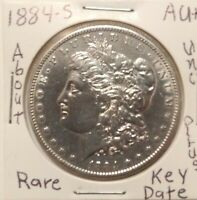1884 S MORGAN SILVER DOLLAR AU ABOUT UNC PLUS  KEY DATE. PRICED TO SELL.