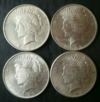 LOT OF FOUR $1 PEACE SILVER DOLLARS