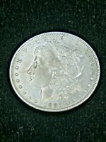 1881 O MORGAN SILVER DOLLAR AU BRIGHT WITH SOME LUSTER IN SAFLIP R63