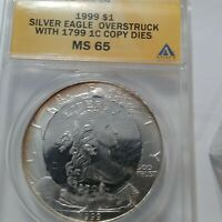 1999 SILVER EAGLE OVERSTRUCK WITH 1799 1C  DIES MINT STATE 65 ANACS CERTIFIED