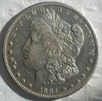 1884 S MORGAN SILVER DOLLAR VG CONDITION.  BUT SHE HAS A RIM DING . KEY DATE.