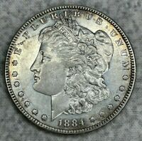 1884 MORGAN DOLLAR UNCERTIFIED COIN - PROOFLIKE SURFACES