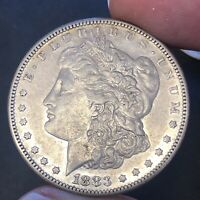 1883-S $1 MORGAN CONDITIONALLY  DATE  AU LUSTER & REFLECTIVITY REMAINS