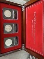 1878 MORGAN SILVER DOLLAR TAIL FEATHER SET IN PCS SLABS WITH LOCKING BOX