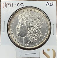 1891-CC MORGAN SILVER DOLLAR ABOUT UNCIRCULATED AUKEY DATE