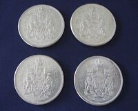 CANADIAN CIRCULATED 1961/62/63/65.50 CENTS..800 SILVER COINS. QUEEN ELIZABETH..B