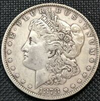 1878 MORGAN SILVER DOLLAR 7-TAIL FEATHERS CIRCULATED,UNCERTIFIED AND UNGRADED