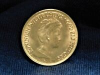 1917 GOLD 10 GUILDER COIN FROM THE NETHERLANDS. GOLD PURITY