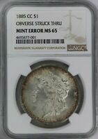 1885-CC NGC SILVER MORGAN DOLLAR MINT STATE 65 OBVERSE STRUCK THRU MINT ERROR