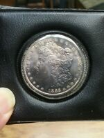 SUPERBLY TONED 1885 O MORGAN DOLLAR SEALED IN 1ST NATIONAL BANK OF ARIZONA POUCH