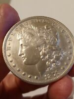 1879 MORGAN SILVER DOLLAR, BEAUTIFUL FEW SCRATCHES BUT LOOKS UNCIRCULATED LE511