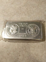 SOUTH EAST REFINING 10 OZ .999 FINE SILVER BAR WITH 1983 MORGAN DOLLAR STAMP