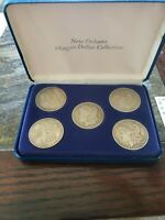 1880, 1881, 1890, 1891 AND 1900 MORGAN SILVER DOLLARS IN CASE AND CERTIFICATE