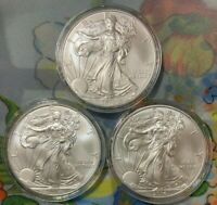 THREE 3 - 2014 SILVER EAGLE COINS  FROM  ROLL  BU