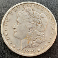 1878 MORGAN SILVER DOLLAR.  I CANNOT TELL IF 7/8 OR 8TF OR WHAT VAM.