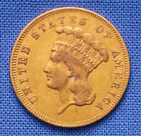 1857 THREE DOLLAR GOLD U.S. COIN.  DATE WITH SCRATCHES. .