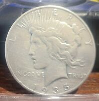 1935 SILVER PEACE DOLLAR - VF  MAY HAVE BEEN DIPPED - SHOWS WEAR AND LUSTER  21