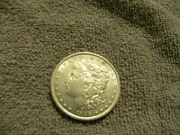 1886 MORGAN SILVER DOLLAR BRIGHT UNCIRCULATED. CLEANED