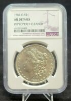1884-0 MORGAN SILVER DOLLAR NGC AU DETAILS: IMPROPERLY CLEANED G549