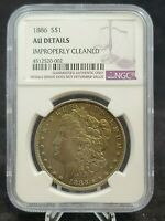 1886 MORGAN SILVER DOLLAR TONED NGC AU DETAILS: IMPROPERLY CLEANED G554