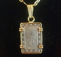 HAND MADE IN 18 K BEZEL HOUSED AN JAPANESE  OLD SILVER COIN PENDANT