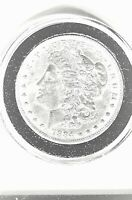 1884-P MORGAN SILVER DOLLAR, BRILLIANT, UNCIRCULATED, IN PLASTIC HOLDER.