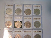 COLLECTION OF 12 CHINA FANTASY DOLLARS   1616 THRU 1874   IN SEQUENCE   HOLDERED