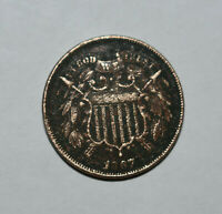 15. AN 1867 TWO CENT COIN HAS ENTIRE