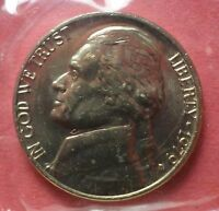 A 1979 D UNCIRCULATED JEFFERSON NICKEL STILL IN CELLO FROM THE MINT A 445